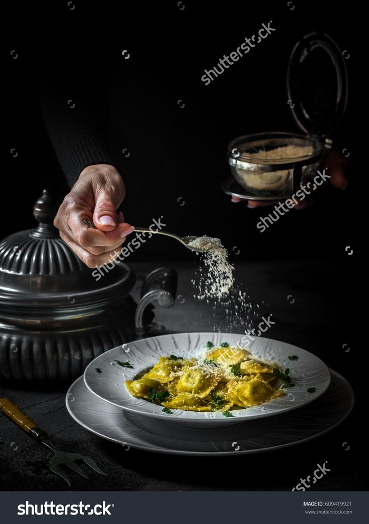 Italian ravioli in the plate on the dark background