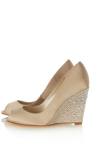 This champagne peep wedge has a stunning crystal encrusted heel that forms  a skinny point.