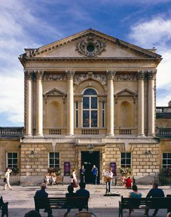 Image: view of the entrance to the Roman Baths from Abbey Churchyard