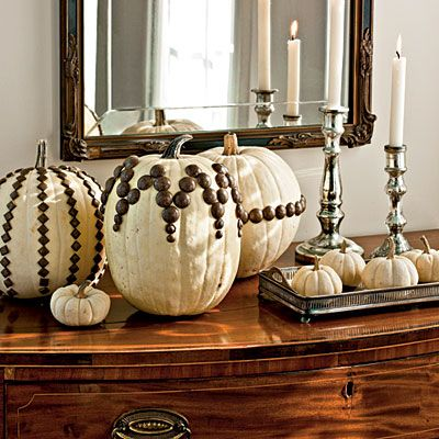 For next fall - white pumpkins decorated with upholstery tacks.