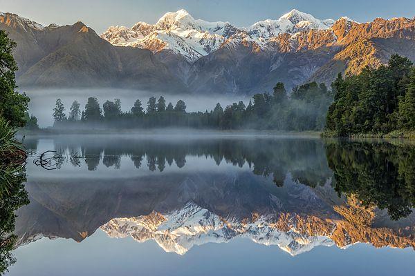 Mt Cook and M. Tasman reflected in lake Matheson, New Zealand. #nz #newzealand water #unesco #nature #art #water #mtcook #westland