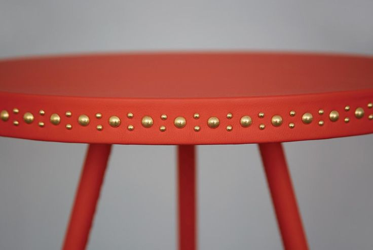 Coral leather and brass studs http://bethangray.com/products/stud-occasional-1