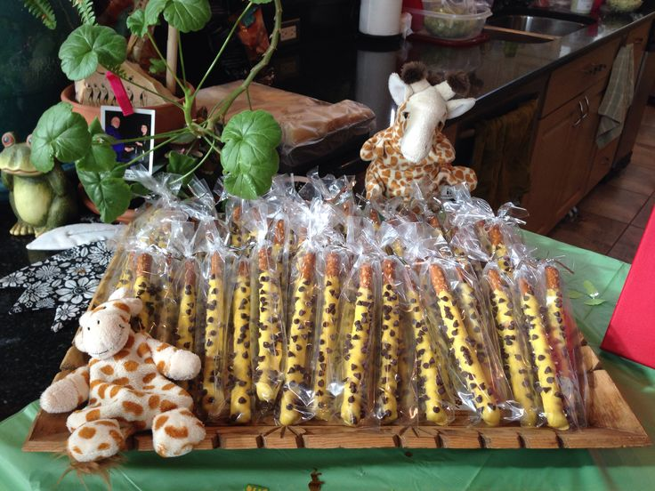 Safari themed baby shower. Giraffes. Chocolate dipped pretzel rods with mini chocolate chips.