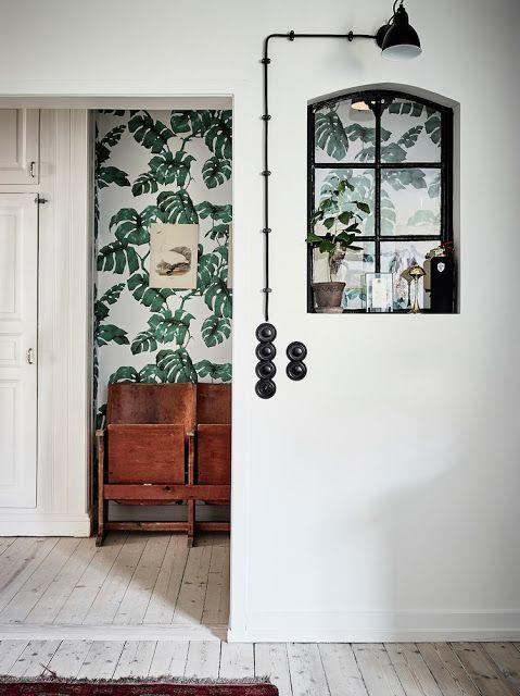 a peek of leafy wallpaper