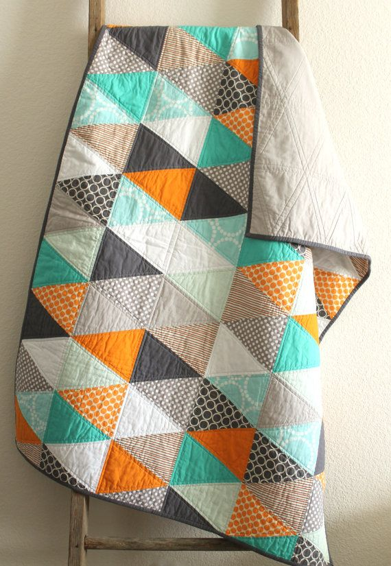 a cheerful isosceles triangle baby quilt. by craftyblossom on Etsy
