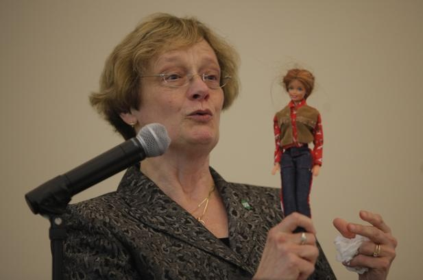 "Dr. Lisa Rossbacher, president of Southern Polytechnic State University, shows off what she calls ""Technology Barbie"" during her speech, entitled ""STEM, stereotypes, and stromboli: How Technology Barbie earned an 'A,'"" at Dalton State College on Friday."