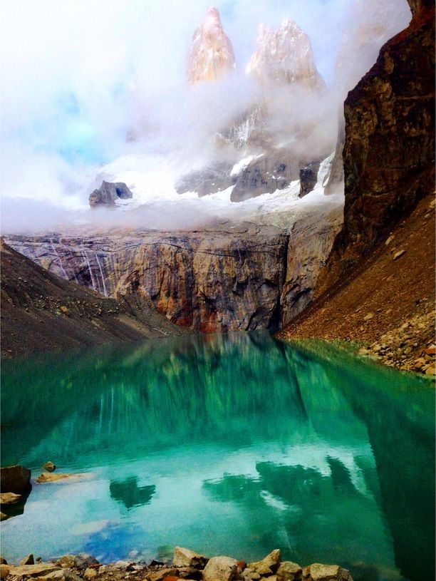 Torres del Paine, Chile, Puerto Natales, Chile — by Erin Burt. The granite pillars of Torres del Paine finally started to reveal themselves from the fog after a 2 hour hike for...