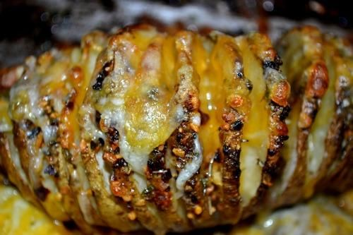 Sliced Baked Potatoes -- A delicious twist on Baked Potatoes -- they are sliced, with herbs, butter and cheese added. Yum!