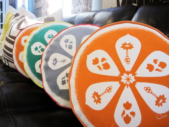 Round Pillow Orange Teal or Gray Silk Screened by erinflett. , via Etsy.