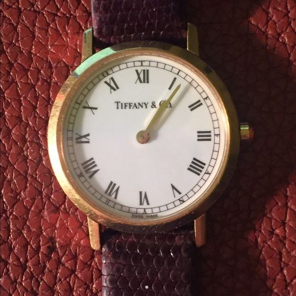 Tiffany watch 18k Yellow gold Authentic ladies Tiffany watch, leather band, yellow  gold, bought in 1996, needs battery. Tiffany & Co. Accessories Watches