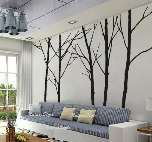 Wall decal for the living room then add pictures for leaves?? We can totally DIY this.