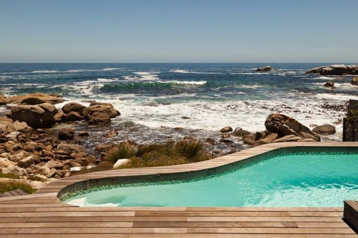 Deck leading to pool and sea with outdoor shower