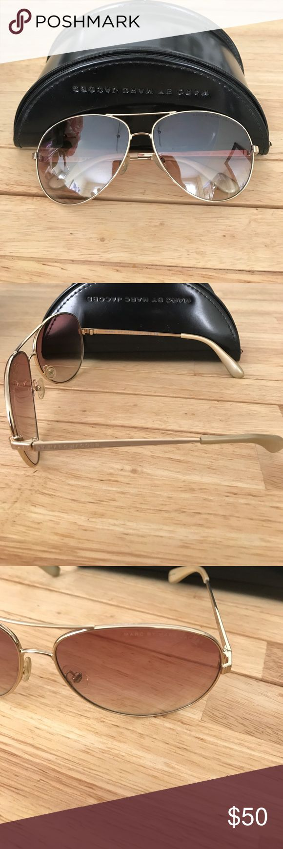Marc by Marc Jacob Aviator Sunglasses Brown/Gold Never worn Marc by Marc Jacob Aviators! No scratches at all, like new. Comes with case. Lenses are light brown with gold/copper frames. 55mm Marc By Marc Jacobs Accessories Sunglasses