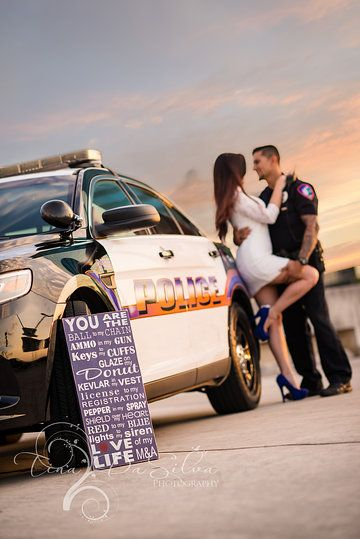 Police theme engagement photos by Tina DaSilva Photography