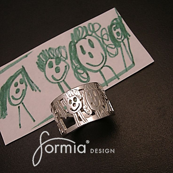 A ring made from your child's artwork! HOW STINKING COOL! I am going to have to get one of these. Maybe have each kid draw a pic of themselves. This would be an amazing mothers day gift!
