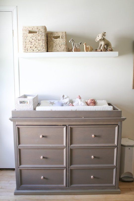 Dresser can be turned into a changing table. With a shelf over it, you can store the diapers and other changing necessities.
