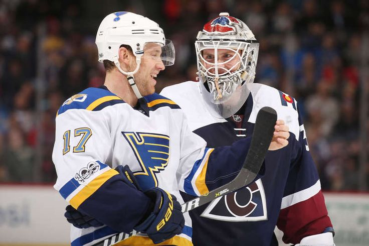 DENVER, CO - MARCH 31: Goaltender Calvin Pickard #31 of the Colorado Avalanche talks to Jaden Schwartz #17 of the St. Louis Blues during a break in the action at the Pepsi Center on March 31, 2017 in Denver, Colorado. (Photo by Michael Martin/NHLI via Getty Images)
