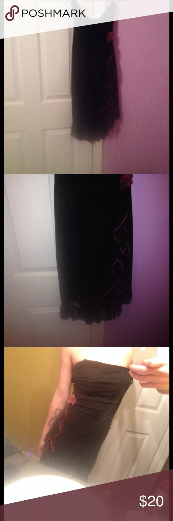 Strapless little black dress.!😍 This dress is strapless it has a pinkish colored rose on the side with a fringe type seam down the side. It's great for the summer or even a nice dinner date dress! Kinda reminds me of a Tango dress lol! Dresses Strapless