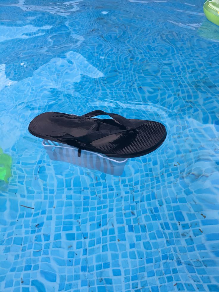 DIY Floating chlorine Dispenser for a swimming pool.  Zip tie a small plastic basket to a flip flop.