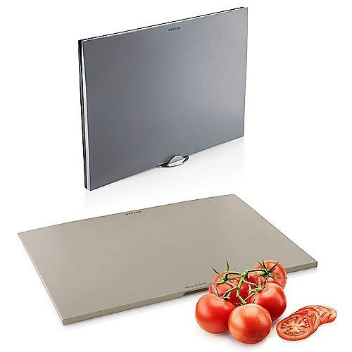 The Eva Solo Chopping Board Set includes 3 plastic chopping boards in different shades of grey to help keep different kinds of food (meat, fish, produce) separate during preparation. Each has a tapered easy-to-grip edge. The set includes an aluminum stand for upright storage.