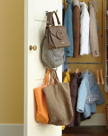 Organize Totes and Purses  With guests flowing in, a closet can quickly become a Wild West of bags. Wrangle totes by mounting hooks on the inside of your foyer closet's door. Chrome garment hooks, 5 1/2 inches; containerstore.com.