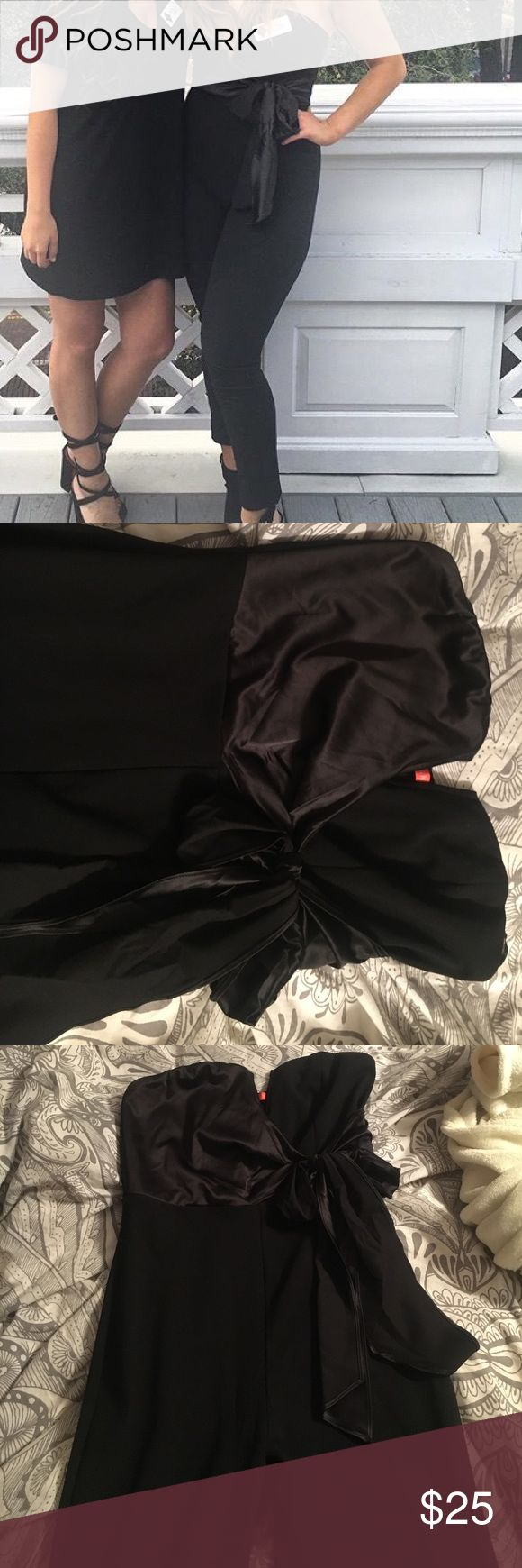 Black Strapless Jumpsuit Black jumpsuit with bow detail. I am 5'5 for size reference. Make me an offer! :) ASOS Pants Jumpsuits & Rompers