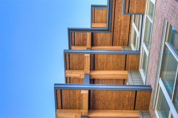 RusticSeries Lap Siding on Allura Fiber Cement as faux wood Soffiting. Multifamily architecture design beautiful!
