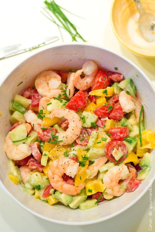 Greek salad with tomatoes, avocado and shrimps