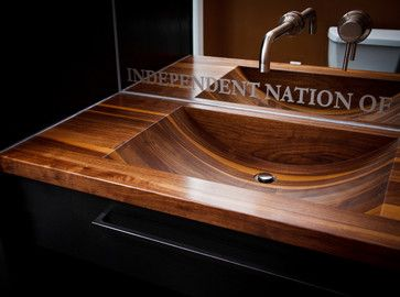 Wood sink Evertsen Brothers, manufactures wood countertops, sinks and bath tubs. All are sealed with a permanent finish that does not require regular maintenance. Mild soap and water clean up only.