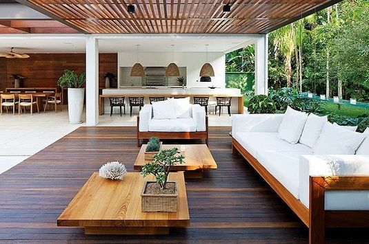 The hardwood flooring is stunning with the modern furniture.