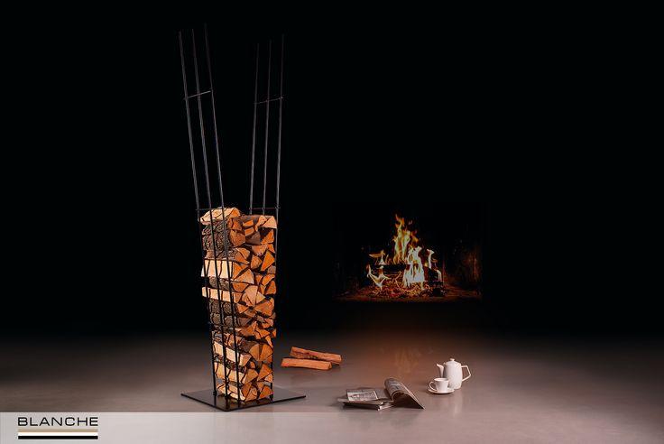 Если в Вашем доме есть традиционный камин, то дрова для него мы советуем хранить на видном месте в качестве модного и колоритного декора. Именно для этого мы разработали оригинальную дровницу, которая поможет эстетично представить дрова в интерьере. В основе ее конструкции лежит простая, но довольно таки необычная идея - при заполнении дровницы металлические прутья расходятся, приобретая форму клина, а по мере использования дров - выпрямляются и становятся параллельными друг другу.