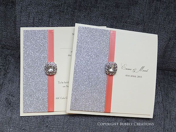 Silver Glitter Wedding Invitation With Coral Ribbon And A Crystal  Embellishment #sparkly #invite #