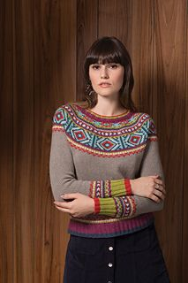 Seven shades of Luma from The Fibre Co. let this Persian-inspired pullover—knit from the top down—shine. The yoke of this slim-fit top is shaped with German short rows. The colors get an extra pop from duplicate stitching on the yoke.
