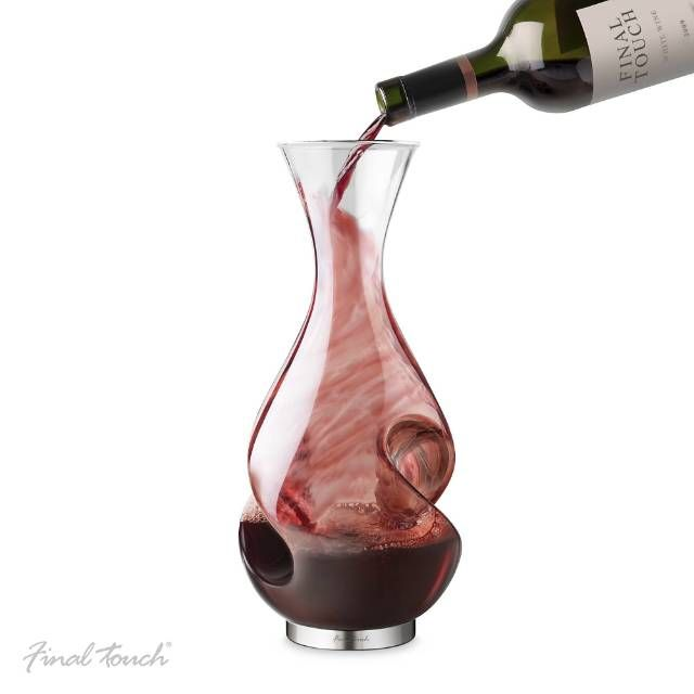 Enhance the flavor and the experience of drinking wine with the L'Grand Conundrum Wine Decanter and Aerator. While pouring wine into the vessel, the wine travels strategically down and over the sides, providing superior aeration and oxygenation. When serving, the wine is gently dispersed over the specially designed curves providing a second aeration phase, which maximizes the scent and flavor of the wine.Aerates wine in two phases: when filling or servingUnique design helps to enhance fla...