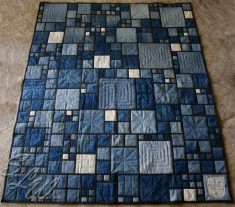 Stained Glass Denim Quilt - note for jbm: i like the random mix of square sizes, the different quilting stitch patterns; the pops of small light squares.