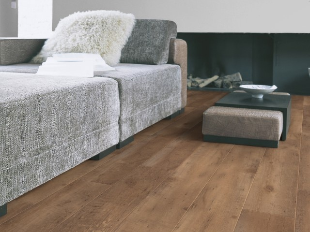 PVC flooring, looks like real wood, does not sound like laminate flooring, and easy to clean; perfect for me!    www.gerflor.com
