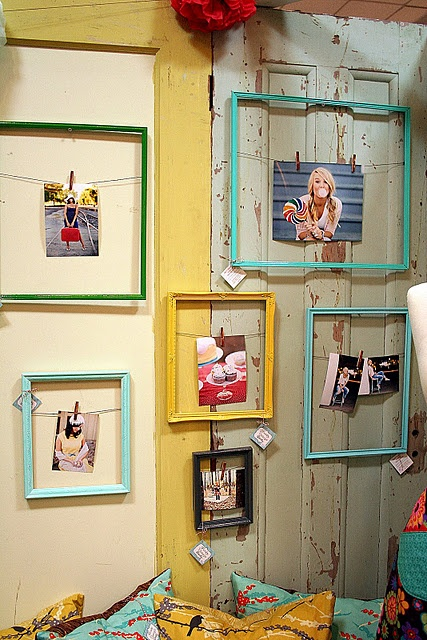 Get some old frames from Goodwill or a yard sale (or that one time, when you dropped a frame and accidentally broke the glass...), spray paint any fun colors or leave natural, attach wire to the back using a staple gun or by twisting the wire around the previously existing grippers, get some clothes pins and your favorite pictures and vuala! You, my friend, are an interior decorator.