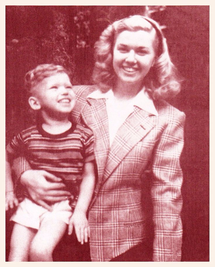 A young Doris Day with son, Terry Melcher (2-8-42), from her first marriage to Al Jordan (1941-43). Terry was her only child. Doris underwent a hysterectomy during the filming of Julie (1956) after being diagnosed with a tumor the size of a grapefruit that was growing into her intestines.