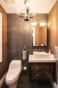 Use leather tiles as a feature wall in a bathroom complimented by light woods and satin nickel hardware.