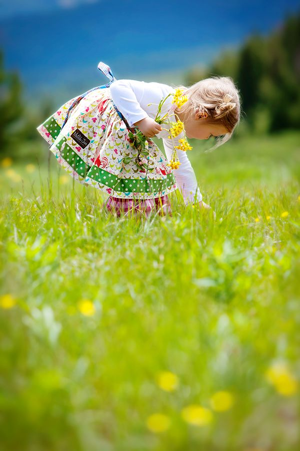 Here's someone picking flowers, looks like pretty yellow blooms..........