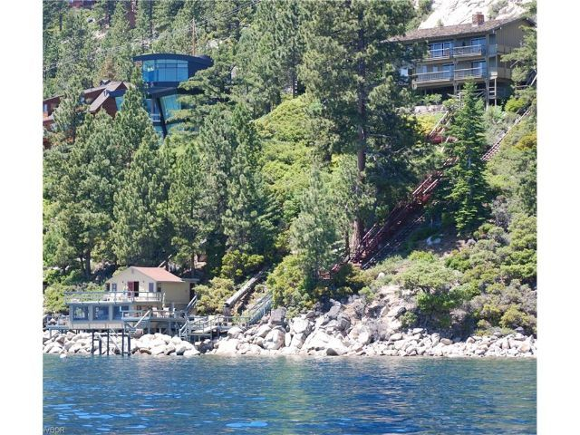 This extremely private Lake Tahoe waterfront home on almost one acre offers two homes and a generous 150 feet of lake frontage. #lakefrontproperties #olre #laketahoe #luxuryhomes #views