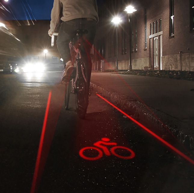 Riding on a road without a bike lane? That's no problem with this graphic light that projects an outlined bike lane behind you at almost one mile away.
