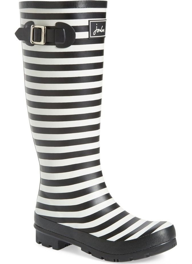 Playful stripes perfect this puddle-proof rubber rain boot set on a traction-gripping sole.