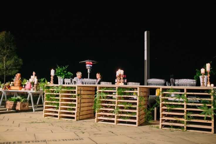 pallets & wooden plank as temporary bar. Clever!