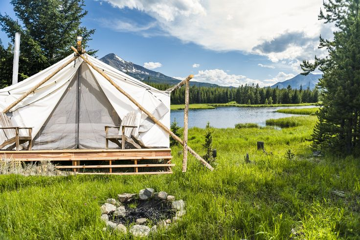 The team behind Collective Retreats built the custom canvas tents with wood that they sourced locally. They used timber they found in the property's vicinity to hold the peaks together at the top. Shown here is the Yellowstone location.