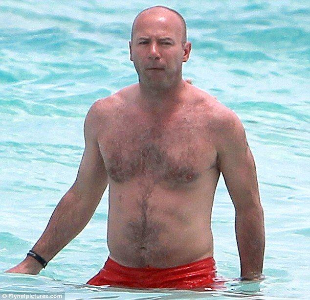 Former England footballer Alan Shearer's balding head is