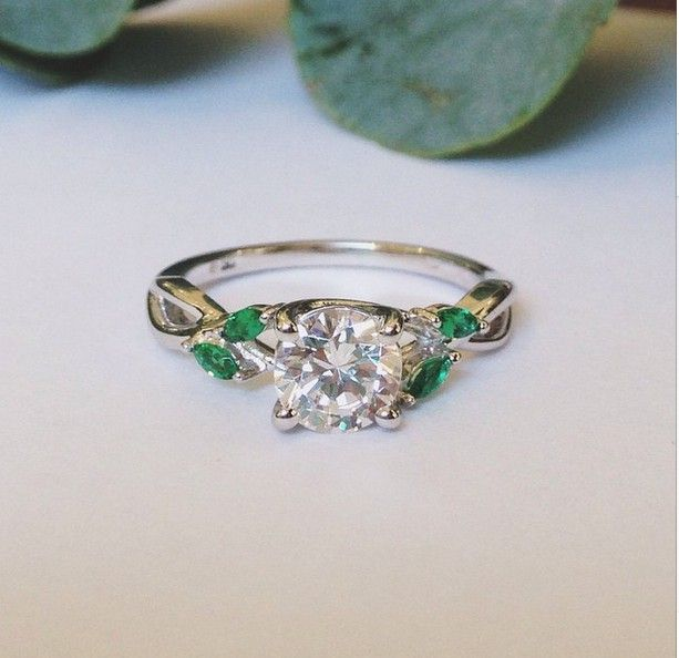 Wispy vines of precious metal entwine toward lustrous marquise emerald buds in this nature-inspired trellis ring.