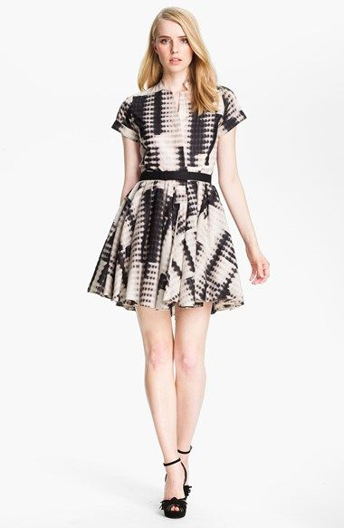 Free shipping and returns on Halston Heritage Belted Abstract Print Dress at Nordstrom.com. A lightweight fit-and-flare dress is grounded with a bold, abstract print that covers the pretty silhouette.