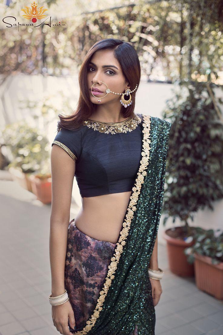 Black raw silk blouse, tussar silk printed sari with a green sequence pallu…