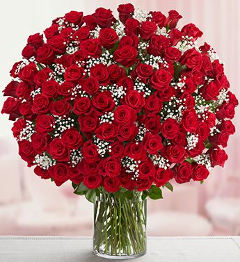Century of Love  (LOVERS PARADISE )  100 stems of Deep Red Roses arranged beautifully in a tall glass vase for your Valentine.